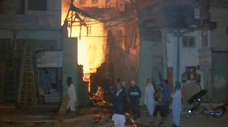 Fire engulfs four wood warehouses in Karachi