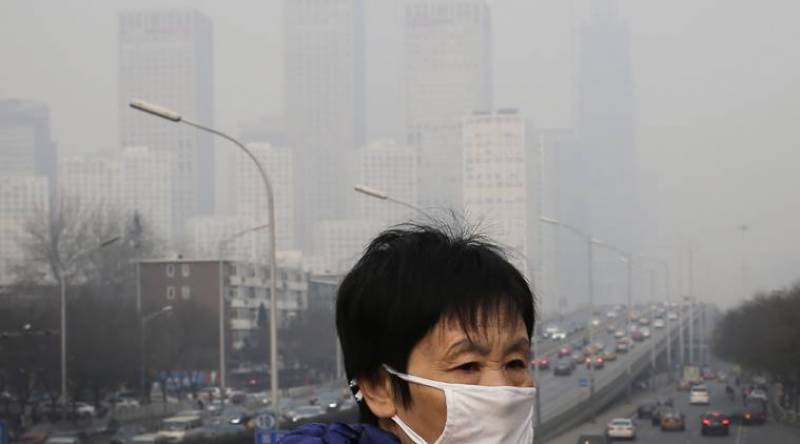 China issues yellow alert for extreme weather, air pollution