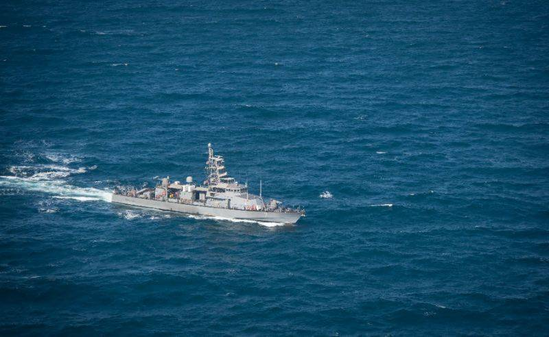 US Navy destroyer fires warning shots at Iranian vessels: officials