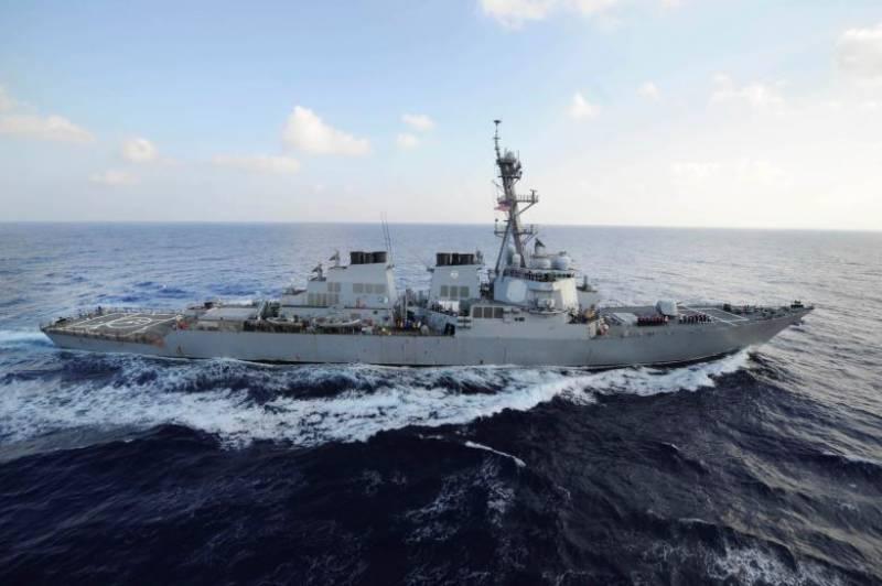 U.S. Navy destroyer fires warning shots at Iranian ships