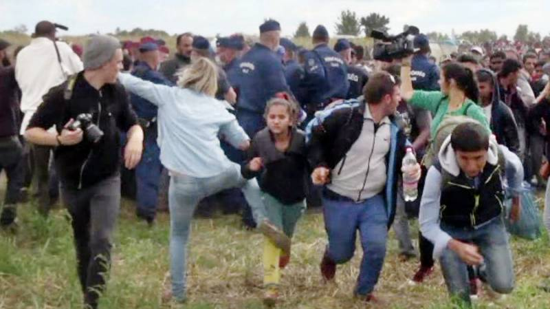 Hungarian camerawoman caught kicking migrants sentenced