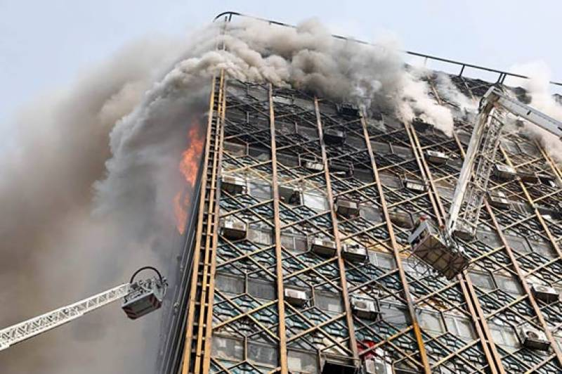 Collapsed building in Tehran traps dozens of firefighters