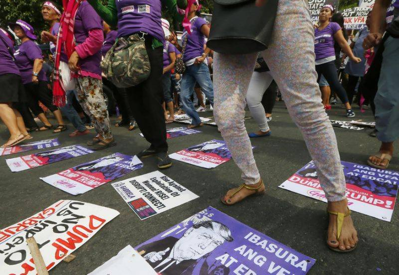 Philippine protesters urge president Duterte to stay away from Trump