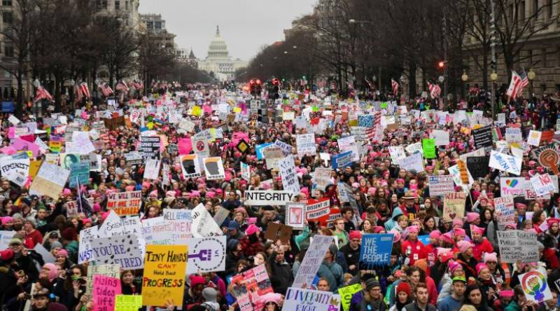 Women lead unprecedented worldwide mass protests against Trump