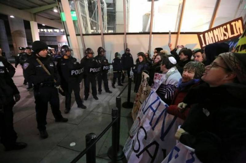 Protests erupt across US as Trump order halts Muslim immigrants