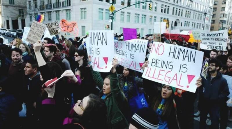 US judge temporarily halts deportations following Trump order