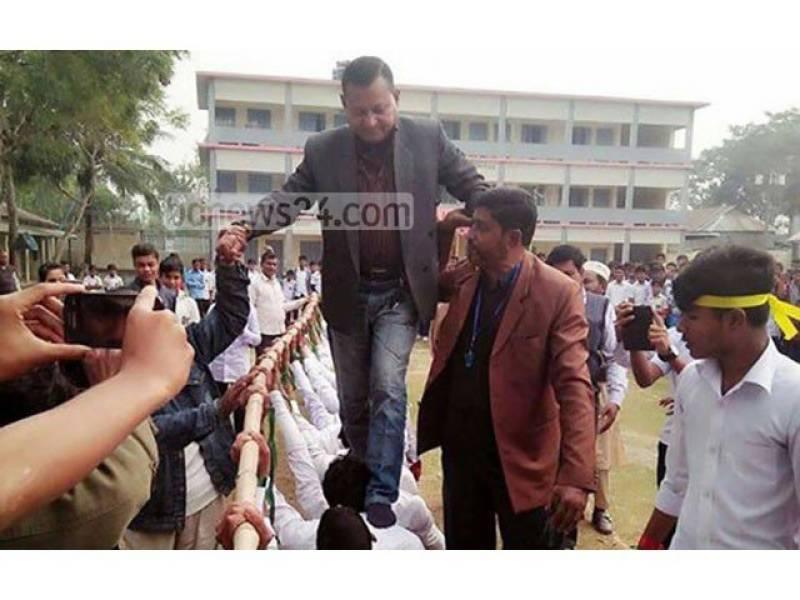 "Bangladeshi politician under fire for walking on ""human bridge"""