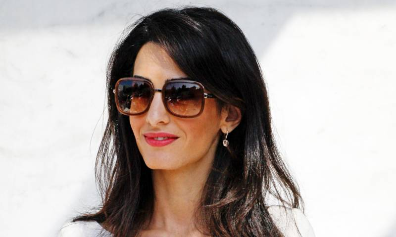 Amal expecting twins