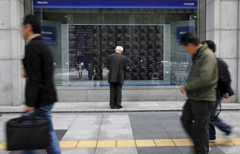 Asian shares slip off 1-1/2-year high