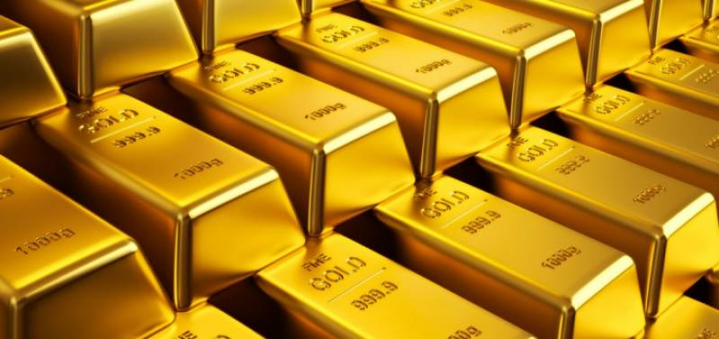 Gold slips to four-week low on Fed rate hike expectations