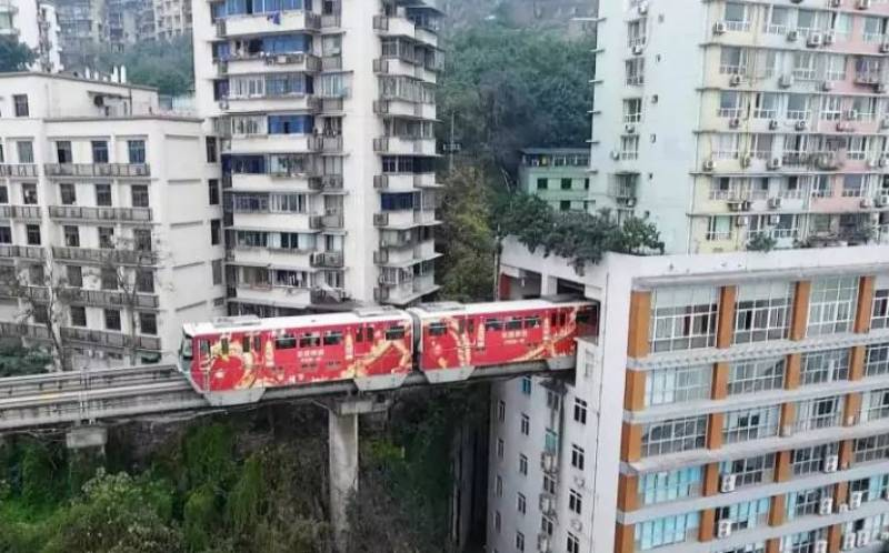 Watch: Chinese train goes through building