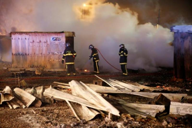 Several injured as fire erupts at France migrant camp