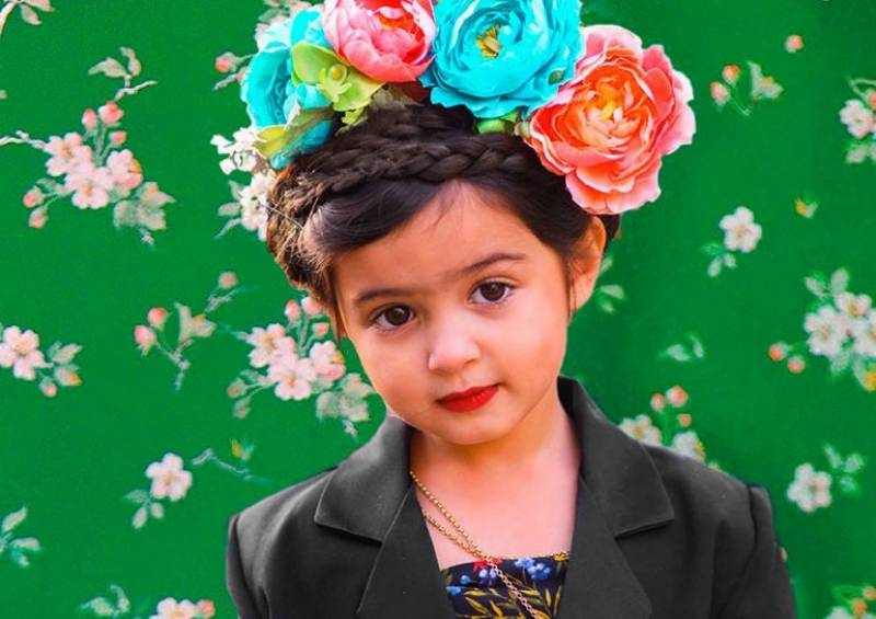 Adorable girl dresses up like strong female icons