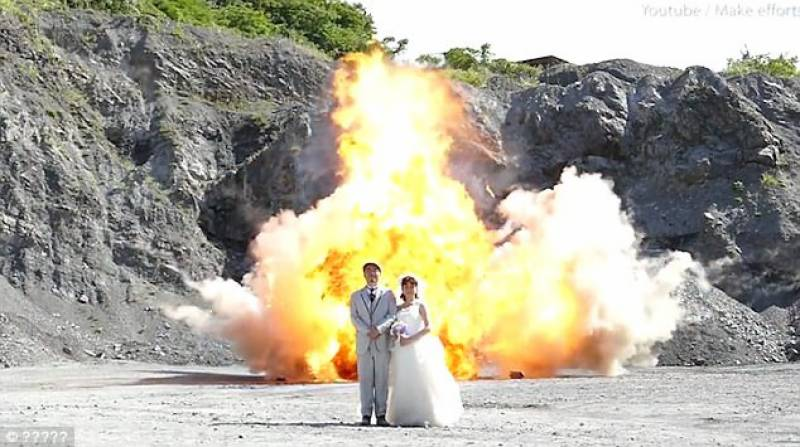 Video: Wedding photo shoot in front of giant explosions