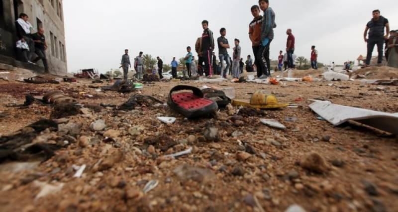Disguised suicide bomber kills 14 in Iraqi refugee camp