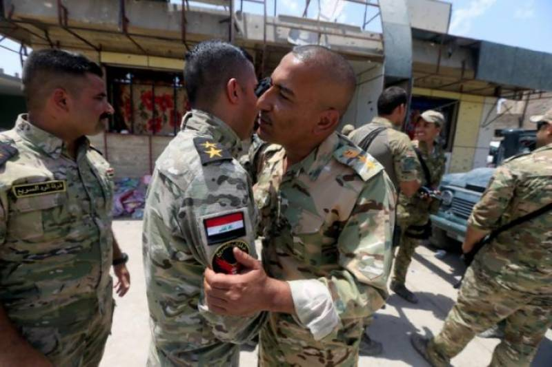 Iraqi army celebrates Mosul victory
