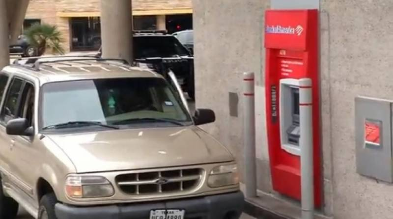 ATM's choices: deposit, withdraw, release trapped repairman