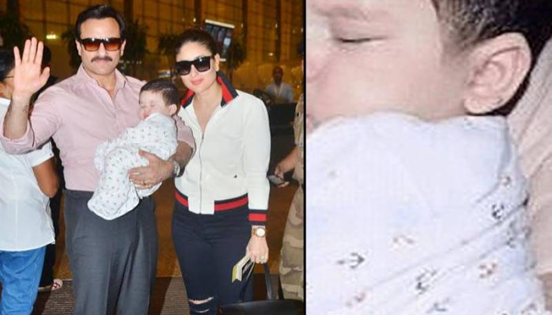 Look! Cute Taimur sleeping in daddy's arms