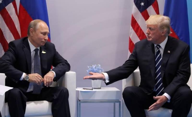 Trump signs Russia sanctions bill, Moscow calls it 'trade war'