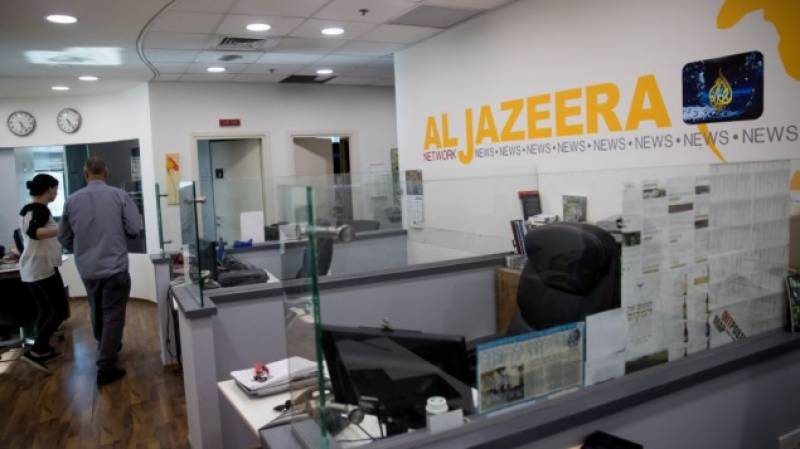 Israel moves to revoke Al Jazeera's press cards, block transmissions