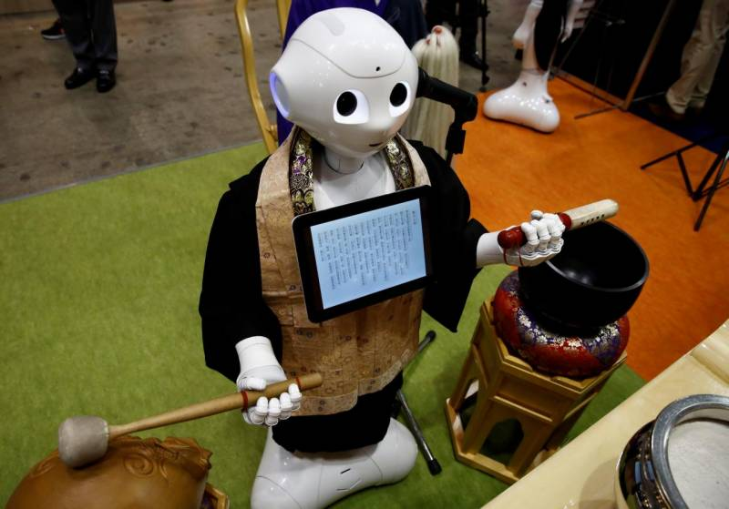 Japan introduces robot to perform funeral rites