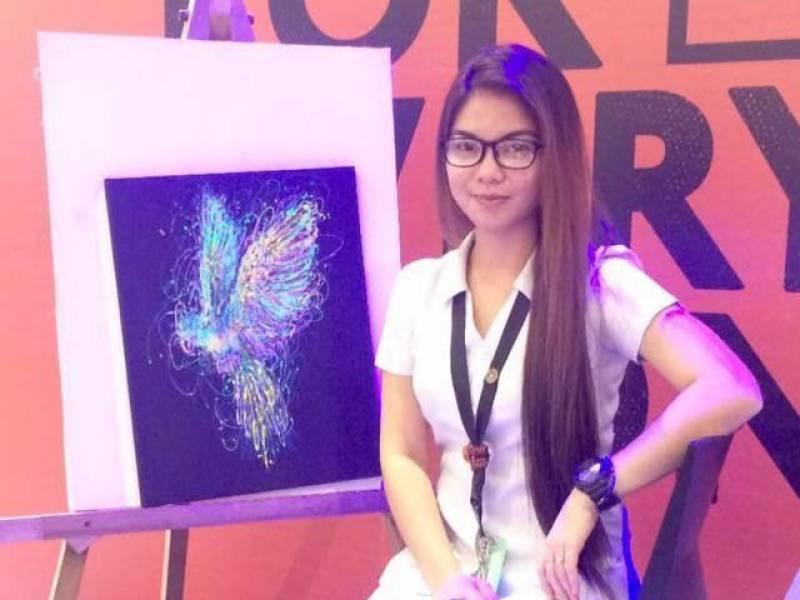 Filipino nurse paints using syringe