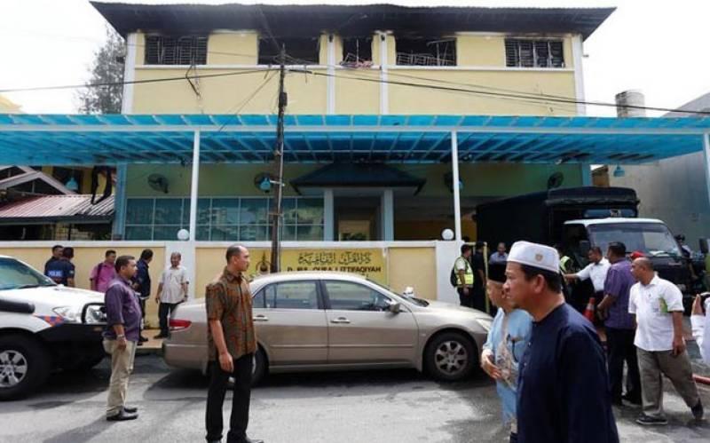 Boys 'cried from barred windows' as Islamic school blaze kills 23 in Malaysia