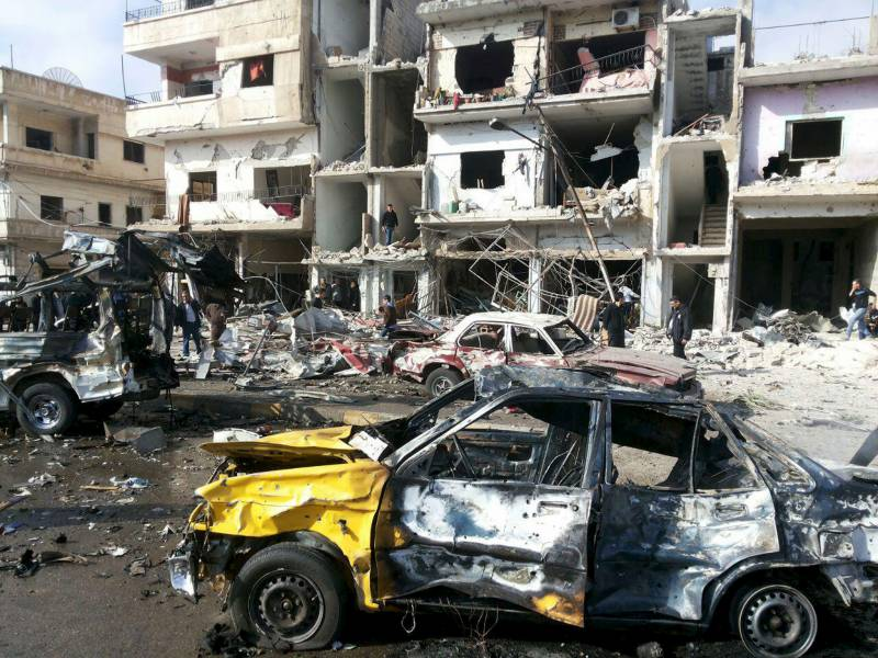 74 killed, dozens injured in twin car bomb and gun attack claimed by IS in Iraq