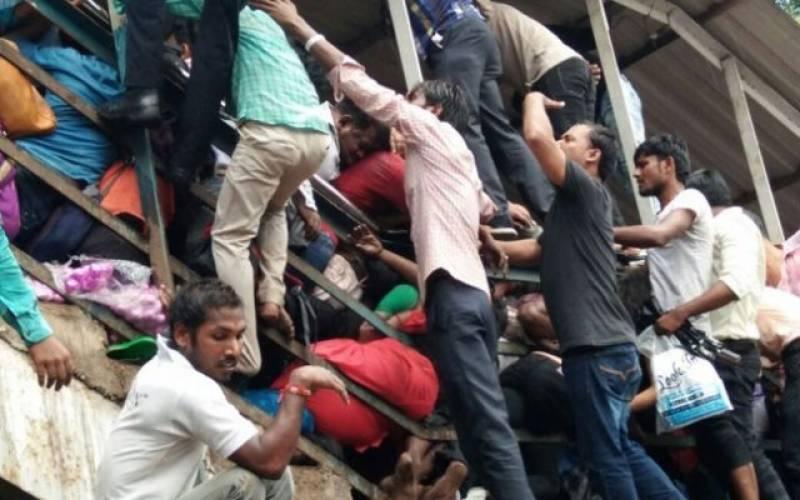 At least 22 dead, dozens injured in Mumbai railway bridge stampede