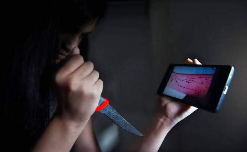 Two girls expelled from college after found playing 'Blue Whale' game