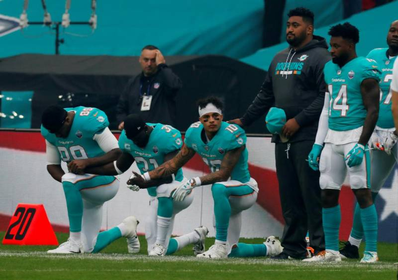 3 Miami Dolphins dare to defy Trump order to stand during anthem