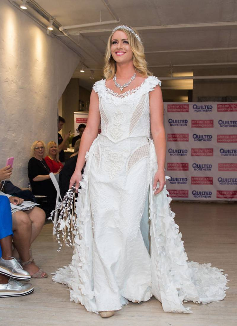 Look toilet paper gown with 1,500 butterflies wins $10,000 first prize