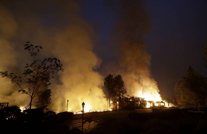 At least 11 dead, hundreds missing as fires rage in Northern California