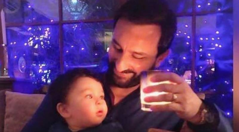 Look! New adorable pics of Taimur with star daddy