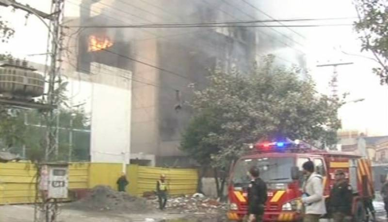 Rescue teams douse fire on MM Alam Road
