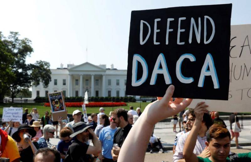US judge blocks Trump move to end DACA program for immigrants