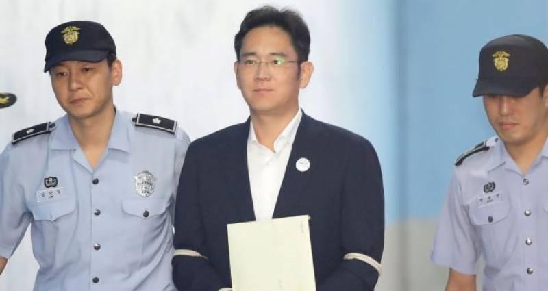 Samsung scion Lee walks free as South Korea court suspends jail term
