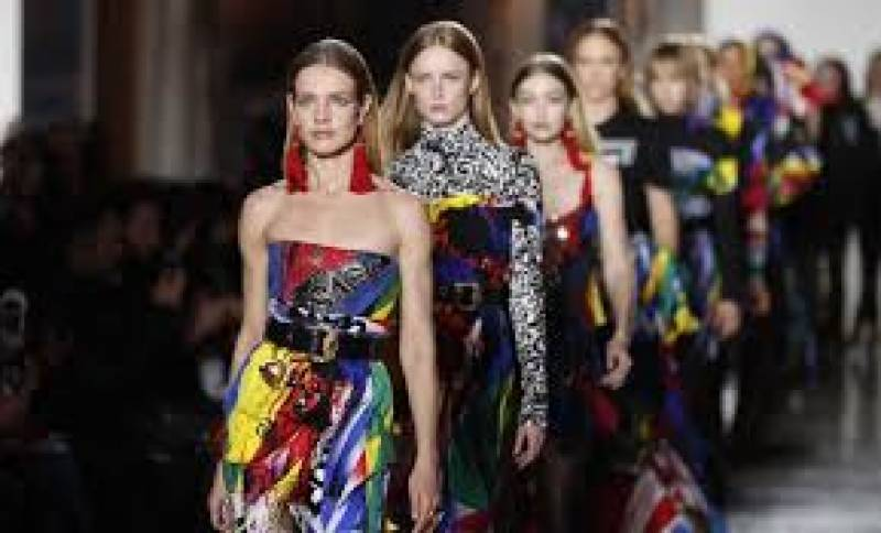 Versace rocks Milan's fashion week with loud college style