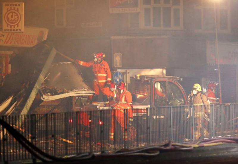 Blast destroys shop and home in English city, six taken to hospital