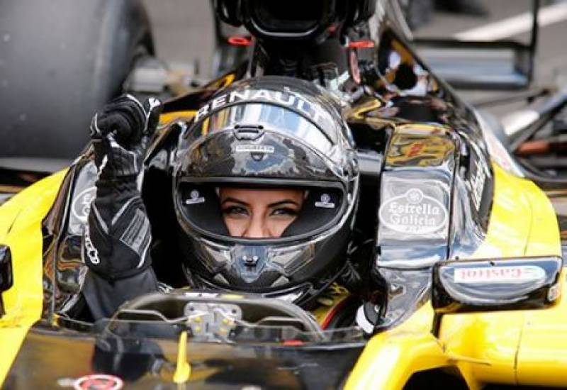 Saudi woman drives F1 car to mark end of ban in ultra-conservative kingdom