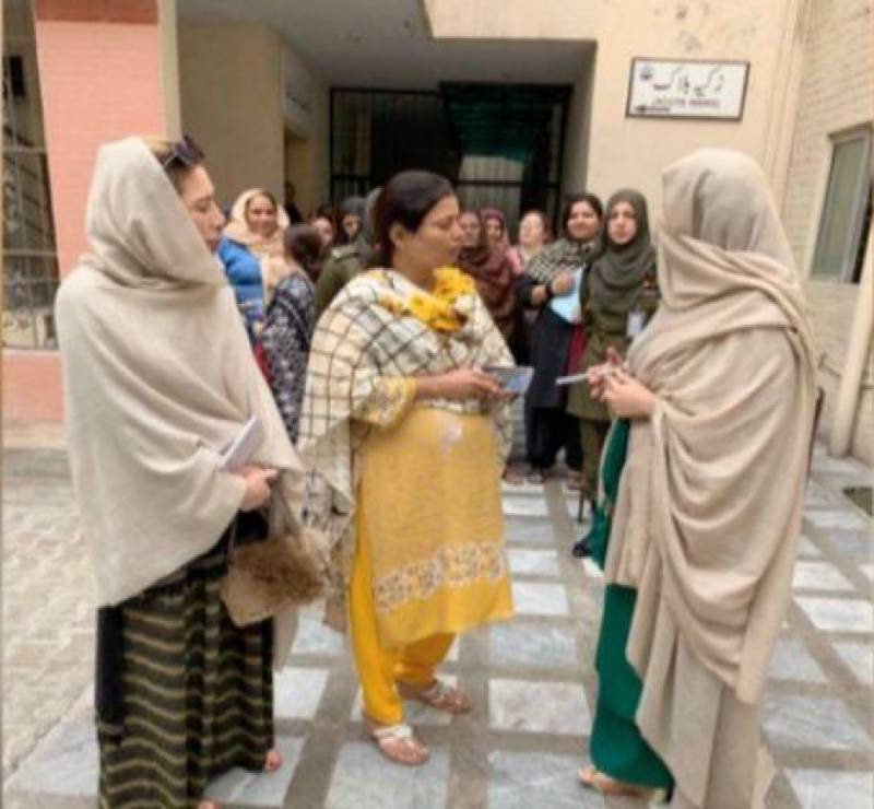 Firstly lady visits Fountain House, spends time with mentally-disabled women, children