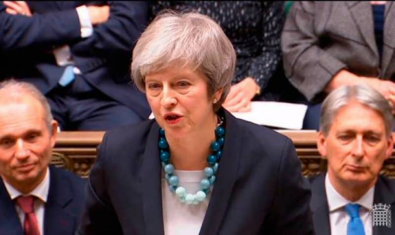 British PM May survives confidence vote, says will quit before next election