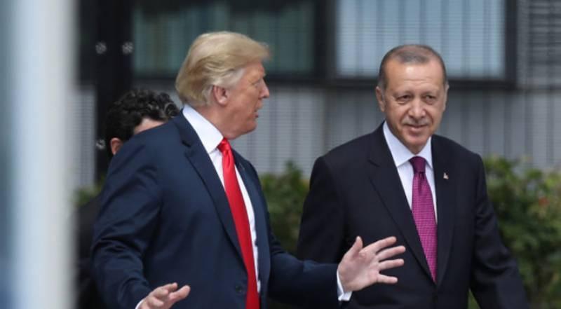 US slaps sanctions on Turkey, demands Syria ceasefire