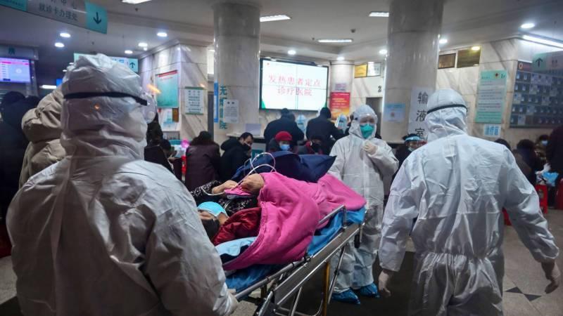 Coronavirus death passes 1,000 as Xi visits frontline hospital