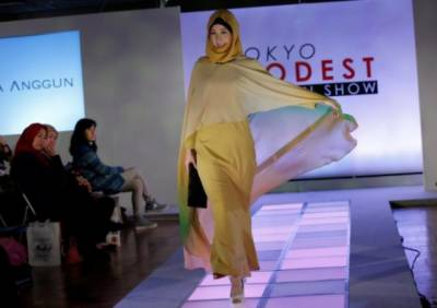 Hijab-clad models walk ramp at fashion show