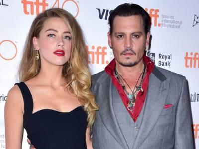 Johnny Depp, Amber Heard finalize bitter divorce