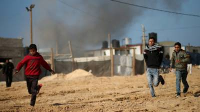 Three Palestinians injured as Israeli strikes target Gaza Strip