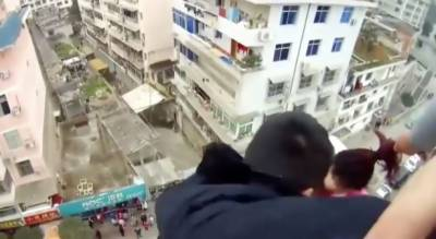 Watch: Husband saves wife by grabbing her hair