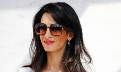 Amal expecting twins