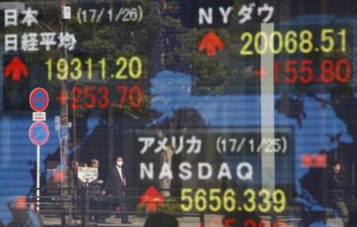 Asian stocks test new 19-month highs